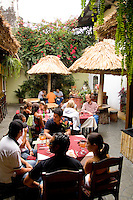 Beautiful courtyard with old carriage in Cuban restaurant called Sabor Cubano restaurant in Antigua Guatemal