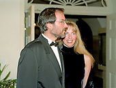Steven Jobs, interim CEO, Apple Computer, and his wife, Laurene Powell Jobs, arrive at The White House in Washington, D.C. on October 29, 1997 for the State Dinner honoring Chinese President Jiang Zemin.  <br /> Credit: Ron Sachs / CNP