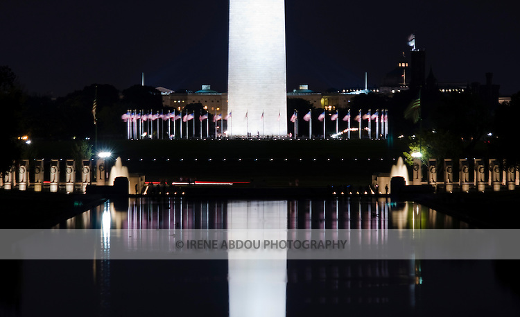 The Washington Monument is reflected in the Reflecting Pool at night.