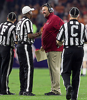 Arkansas Democrat-Gazette/BENJAMIN KRAIN --12/29/14--<br /> Bret Bielema smiles at officials after an Arkansas touchdown in the 4th quarter of the Razorbacks victory over Texas in the Texas Bowl.