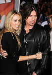 "HOLLYWOOD, CA. - November 17: Tish Cyrus and Musician Billy Ray Cyrus arrive at the World Premiere of Walt Disney's ""Bolt"" at the El Capitan Theatre on November 17, 2008 in Hollywood California."