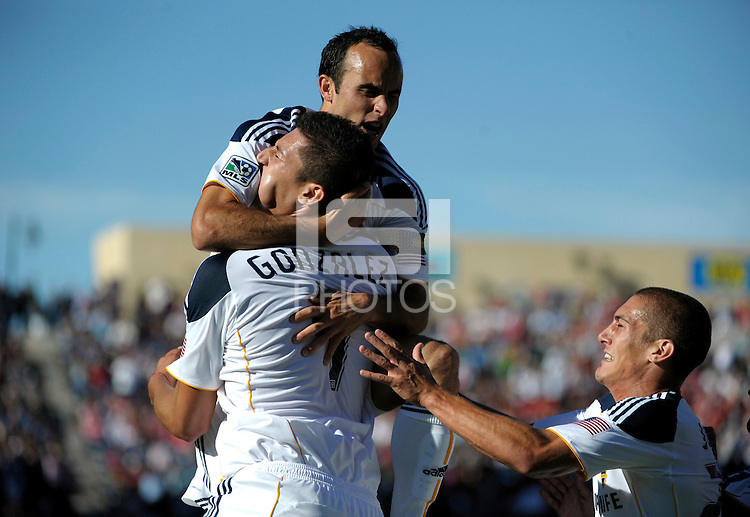 LA Galaxy defender Omar Gonzalez (4) gets a big hug from teammate Landon Donovan (10) after scoring the game tying goal in the 90th minute.  The LA Galaxy tied the Chicago Fire 1-1 at Toyota Park in Bridgeview, IL on September 4, 2010