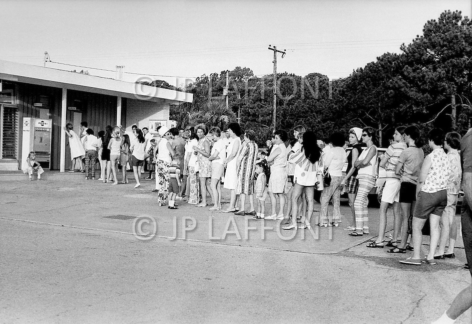 July 16, 1969., Cape Kennedy, Florida, USA --- Line for the bathroom as crowds waiting to watch the launch of Apollo 11 at Kennedy Space Center --- Image by © JP Laffont
