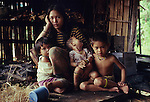 Twenty three years ago: Seventeen year old Den Along (LHS) daughter of Along Sega the renowned resistance fighter, with her daughter Senorita, 1yr old (child in the middle). They are indigenous Penan native people, living as semi-nomadic hunter gatherers. Long Tegang, Limbang district, Sarawak, Borneo 1989<br />