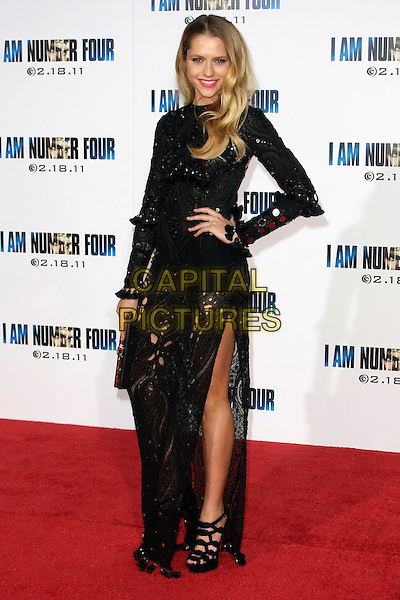 "TERESA PALMER.""I Am Number Four"" Los Angeles Premiere held at the Mann's Village Theatre, Los Angeles, California, USA, .9th February 2011..full length black long sleeve maxi dress sequined sequin paillettes clutch bag sheer see thru through beaded side thigh leg slit split  platform strappy heel christian louboutin sandal foot cut out  hand on hip.CAP/ADM/TB.©Tommaso Boddi/AdMedia/Capital Pictures."