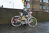 A ghost bike (also referred to as a ghostcycle or WhiteCycle) is a bicycle roadside memorial, placed where a cyclist has been killed or severely injured, usually by a motor vehicle.<br /> <br /> Apart from being a memorial, it is usually intended as a reminder to passing motorists to share the road. Ghost bikes are usually junk bicycles painted white, sometimes with a placard attached, and locked to a suitable object close to the scene of the accident. They are also sometimes stripped of their tires, to deter theft.<br /> <br /> According to The Guardian, the first recorded ghost bike was in St. Louis, Missouri, in 2003. A witness to a collision between a cyclist and a car placed a painted bike at the location with a message that read: &quot;Cyclist struck here&quot;.<br /> <br /> The original idea of painting bikes white reportedly goes back to the city of Amsterdam in the 1960s as an anarchist project to liberate two-wheel transport&mdash;white bikes were free, help yourself and then leave it for someone else.<br /> <br /> The ghost bike idea in the United States may have originated with a project by San Francisco artist Jo Slota, begun in April 2002. This was a purely artistic endeavour. Slota was intrigued by the abandoned bicycles that he found around the city, locked up but stripped of useful parts. He began painting them white, and posted photographs on his website, ghostbike.net. As the idea was taken up for different purposes, Slota faced a dilemma. San Francisco is one of the safer U.S. cities for bicyclists, but memorial ghost bikes sprang up there as elsewhere, changing perceptions of his project.<br /> <br /> Stock Photo by Paddy Bergin