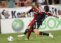 WASHINGTON, DC. - AUGUST 22, 2012:  Dejan Jakovic (5) of DC United slides into  Sherjill McDonald (7) of the Chicago Fire during an MLS match at RFK Stadium, in Washington DC,  on August 22. United won 4-2.