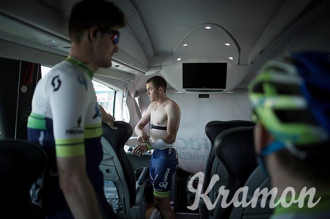 Simon Gerrans (AUS/Orica-GreenEDGE) prepping himself on the teambus<br /> <br /> 2015 Giro<br /> st4: Chiavari - La Spezia (150km)