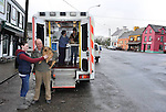 Mobile vet Francois Walsh and Bridget Delahunty examine Una O'Sullivan's pet dog 'Hector' and Gerard O'Sullivan's dog 'Lily' from the back of a converted ambulance in Sneem, County Kerry on Thursday..Picture by Don MacMonagle