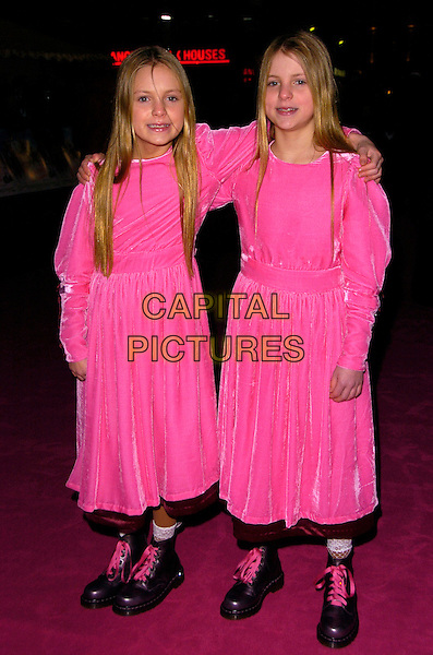 """CHOLE MACKIE & HOLLY MACKIE.The UK Film Premiere of """"St. Trinian's"""" held at the Empire Leicester Square, London, England..December 10th 2007.full length twins sisters pink dresses matching doc martens boots siblings family .CAP/CAN.©Can Nguyen/Capital Pictures"""