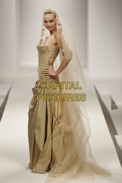 MODEL.Rober Abi Nader Spring/Summer Haute Couture Collection Fashion Show, Paris, France, January 25th 2005..full length catwalk  gold green wedding dress veil tiara.**UK SALES ONLY**.Ref: MDS.www.capitalpictures.com.sales@capitalpictures.com.©SGrimwood/O.Medias/Capital Pictures .