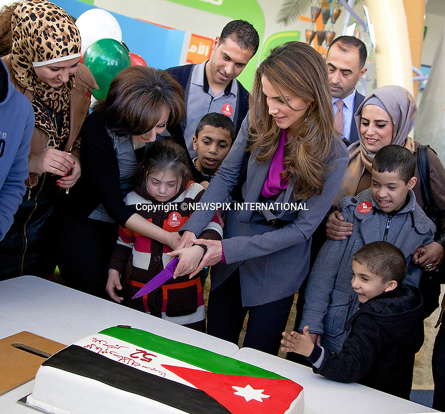 30.01.2014; Amman, Jordan: QUEEN RANIA<br /> helped cut a birthday cake in honour of her husband King Abdullah II's 52nd birthday at the Children's Museum.<br /> Queen Rania Al Abdullah was accompanying a group of children with disabilities to spend a fun filled day at the Museum.<br /> Mandatory Photo Credit: &copy;Royal Hashemite Court/NEWSPIX INTERNATIONAL<br /> <br /> **ALL FEES PAYABLE TO: &quot;NEWSPIX INTERNATIONAL&quot;**<br /> <br /> PHOTO CREDIT MANDATORY!!: NEWSPIX INTERNATIONAL(Failure to credit will incur a surcharge of 100% of reproduction fees)<br /> <br /> IMMEDIATE CONFIRMATION OF USAGE REQUIRED:<br /> Newspix International, 31 Chinnery Hill, Bishop's Stortford, ENGLAND CM23 3PS<br /> Tel:+441279 324672  ; Fax: +441279656877<br /> Mobile:  0777568 1153<br /> e-mail: info@newspixinternational.co.uk
