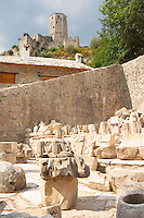 The court yard outside the mosque with architectural stone elements. View up to the tower fortress. Pocitelj historic Muslim and Christian village near Mostar. Federation Bosne i Hercegovine. Bosnia Herzegovina, Europe.