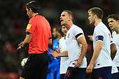 27th March 2018, Wembley Stadium, London, England; International Football Friendly, England versus Italy; Jordan Henderson of England complains to the referee Deniz Aytekin as he awards a penalty via the VAR system