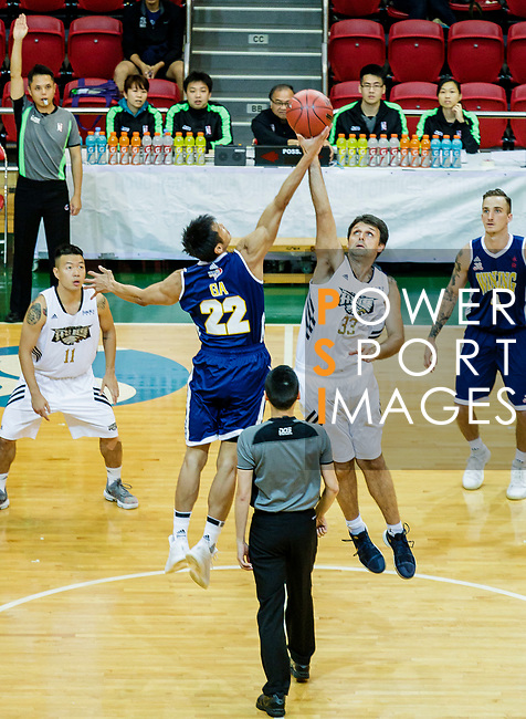 The opening tip between Stefanovski Aleksawdar #33 of Eagle Basketball Team and Fong Shing Yee #22 of Winling Basketball Club during the Hong Kong Basketball League game between Eagle and Winling at Southorn Stadium on May 4, 2018 in Hong Kong. Photo by Yu Chun Christopher Wong / Power Sport Images