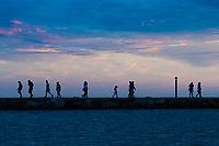 People wandering on the seafront at the town of Novigrad, Istria County, Croatia