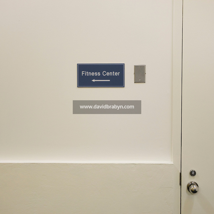View of a sign indicating the direction of the fitness center at the Pitney Bowes world headquarters in Stamford, CT, United States, 7 October 2008.