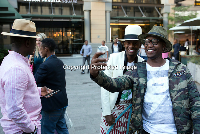 JOHANNESBURG, SOUTH AFRICA - MARCH 12: Street fashion before a show at Johannesburg Fashion Week week on March 12, 2016, at Nelson Mandela Square Johannesburg, South Africa. (Photo by: Per-Anders Pettersson)