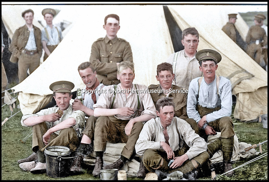 BNPs.co.uk (01202 558833)<br /> Pic: NorthHertsMuseumsService/BNPS<br /> <br /> ***Please Use Full Byline***<br /> <br /> Hertordshire Regiment Territorials rest during Summer Camp on the eve of the outbreak of war. <br /> <br /> Black and white photos of British Tommies preparing for the First World War have been brought to life after they were digitally colourised to mark the 100th anniversary of the start of the conflict.<br /> <br /> Some of the snaps show soldiers in vivid colour getting battle-ready at training camps in the Home Counties in July 1914.<br /> <br /> Others depict the men dressed in their smart green uniforms on parade in a market square on the eve of war and then stood on a train station platform as they head off for France.<br />  <br /> As well as being filled with colour, some of the photos are tinged with poignancy as many of the men pictured never came back.