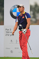 Cao Yi (CHN) tees off the 4th tee during Thursday's Round 1 of the 2014 BMW Masters held at Lake Malaren, Shanghai, China 30th October 2014.<br /> Picture: Eoin Clarke www.golffile.ie