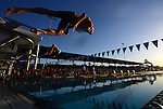 MESA, AZ - APRIL 24:  Michael Phelps (right) and Ryan Lochte (below) dive from the block at the start of the Men's 100M Butterfly Final during the Grand Prix of Swimming on April 24, 2014 in Mesa, California. Lochte finished 1st and Phelps 2nd. (Photo by Donald Miralle for Sports Illustrated)