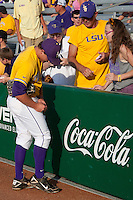 LSU Tigers outfielder Mason Katz #8 signs an autograph before the NCAA Super Regional baseball game against Stony Brook on June 10, 2012 at Alex Box Stadium in Baton Rouge, Louisiana. Stony Brook defeated LSU 7-2 to advance to the College World Series. (Andrew Woolley/Four Seam Images)