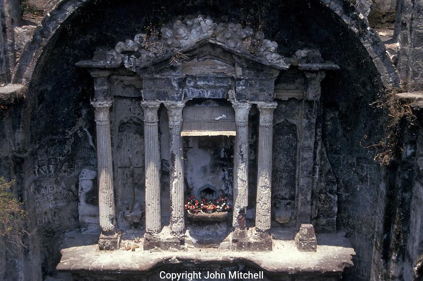 Altar of the ruined Templo de San Juan Parangaricutiro near Angahuan, Michoacan, Mexico. In 1943, this church was half-buried by a lava flow from nearby Volcan Paricutin.