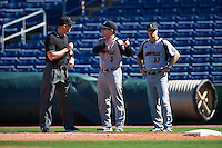 Louisville Cardinals head coach Dan McDonnell (3) argues a call with first base umpire Shane Livingsparger as first base coach Adam Vrable (37) looks on during a game against the Ball State Cardinals on February 19, 2017 at Spectrum Field in Clearwater, Florida.  Louisville defeated Ball State 10-4.  (Mike Janes/Four Seam Images)