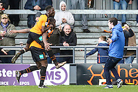 John Akinde of Barnet (2nd left) celebrates scoring his team's second goal against Luton Town to make it 2-1 during the Sky Bet League 2 match between Barnet and Luton Town at The Hive, London, England on 28 March 2016. Photo by David Horn.