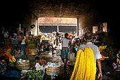 People walk under a bridge near the Mullick Ghat Flower Market in the Howrah area of Kolkata, India, on Friday, May 26, 2017. Photographer: Sanjit Das