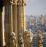 Rows of heraldic lions bearing gilded flags surround the turrets of Victoria Tower