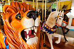 Carousel Lion and horses at historic Nunley's Carousel Centennial Celebration on Saturday, June 9, 2012, at Museum Row, Garden City, Long Island, New York, USA. 100th Anniversary festivities included old time family game of croquet; a visit from ex-President Theodore Roosevelt - portrayed by actor James Foote - who ran again for President in 1912 (unsuccessfully, as Bull Moose Party candidate), the year Nunley's Carousel debuted; and Carousel rides.
