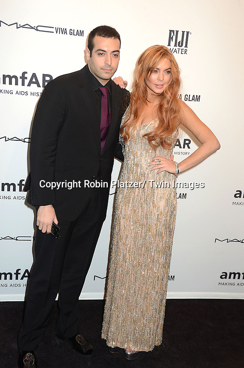 Mohammed Al Turki and Lindsay Lohan attends the amfAR New York Gala to kick off Fashion Week on February 6, 2013 at Cipriani Wall Streetin New York City. The honorees were Heidi Klum, Janet Jackson  and Kenneth Cole.