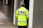 Private security guard outside City of Westminster College, Paddington