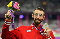 LONDON, ENGLAND 07/09/2012 - Brent Lakatos receives the Silver Medal in the Men's 200m T53 final at the London 2012 Paralympic Games in the Olympic Stadium. (Photo: Phillip MacCallum/Canadian Paralympic Committee)