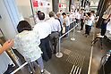 People queue up to buy commemorative stamps celebrating Japan's first gold medal of the Rio 2016 Olympics at the Tokyo Central Post Office in Tokyo, Japan on August 8, 2016. Japanese swimmer Kosuke Hagino won the gold medal in the men's 400m individual medley. (Photo by AFLO)
