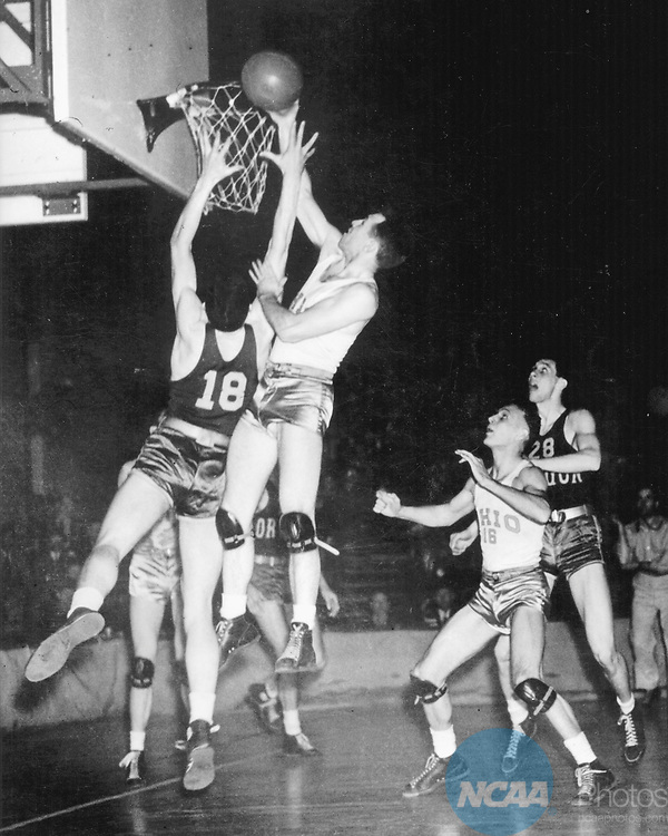 27 MAR 1939:  John Schick of Ohio State (center) making a basket. The first college championship was held March 27,1937 in Evanston, IL. Under the leadership of coach Howard Hobson, the University of Oregon â??Ducksâ? defeated the Ohio State â??Buckeyesâ? 46-33 to become the first college champions.  AP/Wide World Photos
