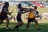 Rangitane Paewae tries to push off Motohi Mou. CMRFU Counties Power Cup Game of the Week between Te Kauwhata & Puni played at Te Kauwhata on Saturday May the 3rd, 2008..Te Kauwhata led 5 - 0 at halftime & went on to win 29 - 0.