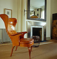 The leather wing-backed armchair in the living area is by the Danish designer Fritz Henningsen and dates from the 1940s