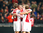 Nederland, Amsterdam, 8 december 2012.Eredivisie.Seizoen 2012-2013.Ajax-FC Groningen.Spelers van Ajax omhelzen Derk Boerrigter van Ajax na zijn doelpunt
