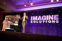 Addison O'Dea, National Geographic Traveler, takes center stage at the second annual Imagine Solutions Conference, held at the Ritz Carlton Golf Resort, Naples, Florida, USA, March 21, 2011.. Photo by Debi Pittman Wilkey.