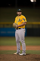 AZL Athletics relief pitcher Dallas Woolfolk (64) prepares to deliver a pitch during an Arizona League game against the AZL Cubs 1 at Sloan Park on June 28, 2018 in Mesa, Arizona. The AZL Athletics defeated the AZL Cubs 1 5-4. (Zachary Lucy/Four Seam Images)