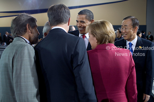 Pittsburgh, PA - September 25, 2009 -- United States President Barack Obama talks with United Nations Secretary-General Ban Ki-moon, right, Chancellor Angela Merkel of Germany and others during the morning plenary session of the G-20 Pittsburgh Summit at the David L. Lawrence Convention Center in Pittsburgh, Pennsylvania, September 25, 2009..Mandatory Credit: Pete Souza - White House via CNP
