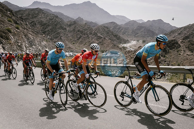 Zhandos Bizhigitov (KAZ) and race leader Alexey Lutsenko (KAZ) Astana Pro Team during Stage 5 of the 10th Tour of Oman 2019, running 152km from Samayil to Jabal Al Akhdhar (Green Mountain), Oman. 20th February 2019.<br /> Picture: ASO/P. Ballet | Cyclefile<br /> All photos usage must carry mandatory copyright credit (© Cyclefile | ASO/P. Ballet)