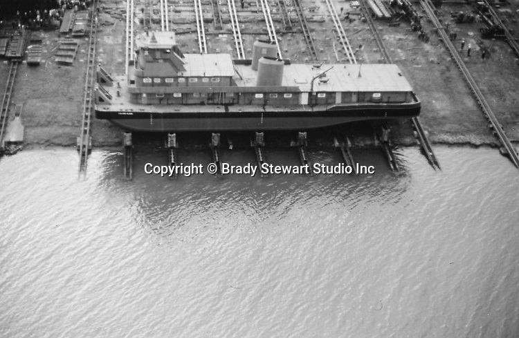 Pittsburgh PA: View of the Dravo shipyard on Neville Island that built tugs and towboats - 1964.  The shipyard started operation in 1919 and closed in 1983. <br /> The new boat was called the Steel Express built for the Ohio Barge Lines.