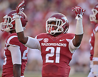 STAFF PHOTO BEN GOFF  @NWABenGoff -- 09/20/14 <br /> Arkansas cornerback Carroll Washington fires up the fans during the first quarter of the game against Northern Illinois in Reynolds Razorback Stadium in Fayetteville on Saturday September 20, 2014.