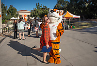 Courtney Stricklin Burgan '03, Sr. Assistant Dean of Admission and Oswald<br /> Explore Occidental - Fall Preview Day, Friday, November 9, 2018.<br /> Fall open house to give prospective students and their families the opportunity to explore Occidental with tours of campus, student and faculty-led discussions, the ability to sit in on a class, and to learn what it means to be an Oxy Tiger.<br /> (Photo by Marc Campos, Occidental College Photographer)