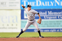 Staten Island Yankees second baseman Ty McFarland (14) throws to first during a game against the Batavia Muckdogs on August 6, 2014 at Dwyer Stadium in Batavia, New York.  Batavia defeated Staten Island 5-3.  (Mike Janes/Four Seam Images)