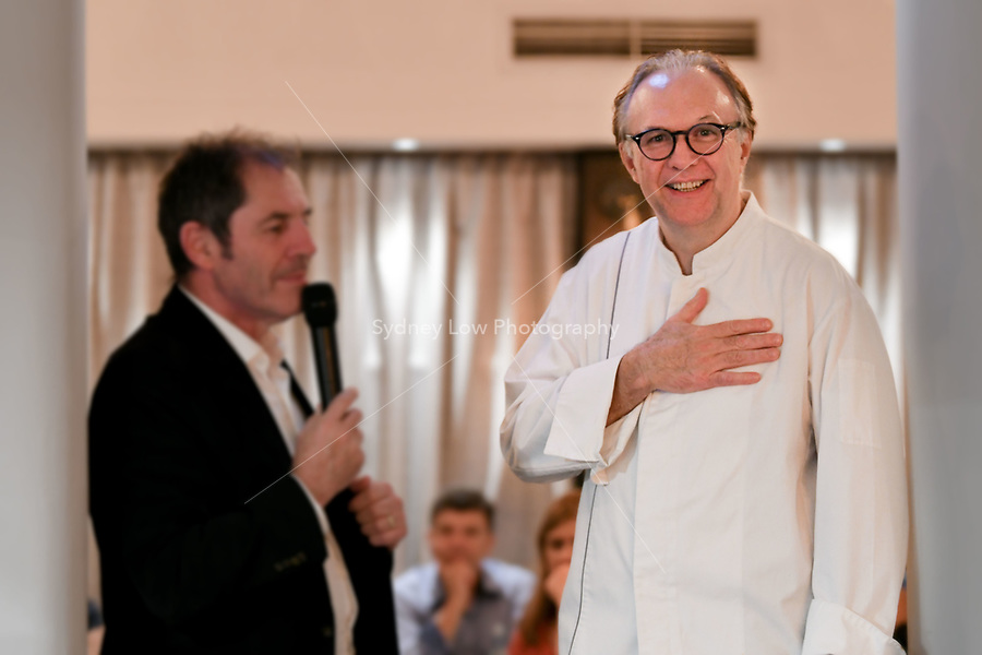 Melbourne, Australia - February 16, 2018: Gabriel Gaté and Philippe Mouchel speak at a tribute dinner for Paul Bocuse at Restaurant Philippe in Melbourne, Australia. Photo Sydney Low