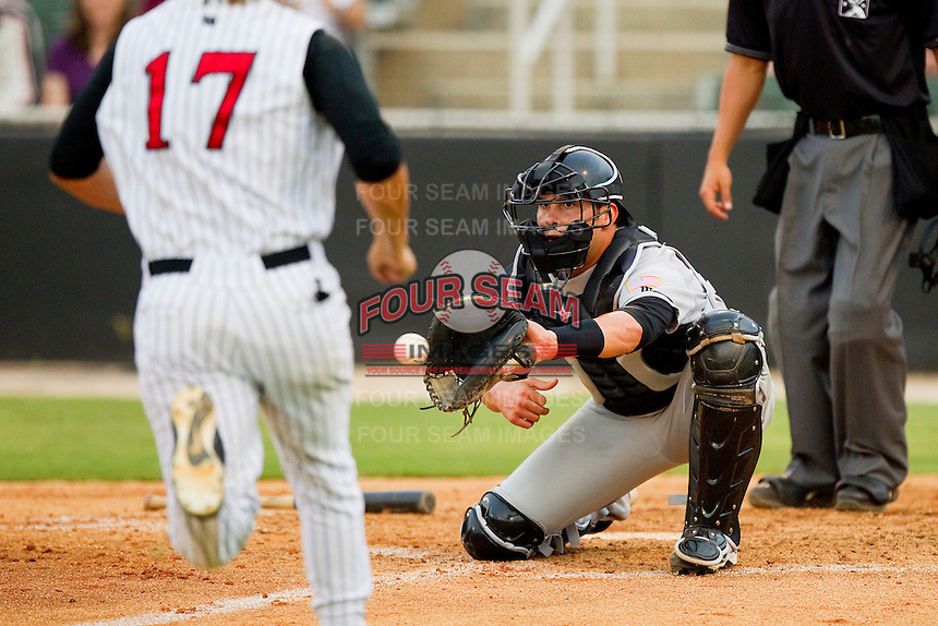 Hagerstown Suns catcher Sam Palace #8 waits for the ball as Ross Wilson #17 of the Kannapolis Intimidators comes running towards home plate at CMC-Northeast Stadium on June 9, 2012 in Kannapolis, North Carolina.  The Suns defeated the Intimidators 11-6.  (Brian Westerholt/Four Seam Images)